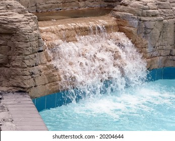 close up of waterfall in a outdoor pool at a resort