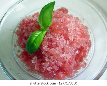 Close up of watermelon granita with basil leaf garnish