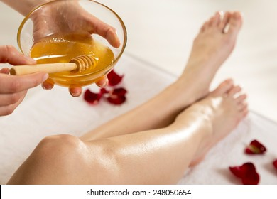 Close up waxing in by a beautician in a spa center