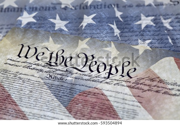 Close up of We the People of the Constitution of the United States of America and the Declaration of Independence with shallow depth of field