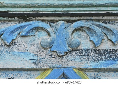 Close up of weathered intricate wooden details on door