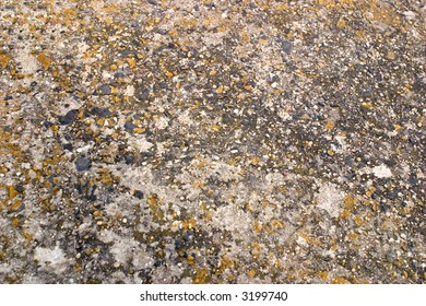 close up of a weathered stone surface, perfect for use as a background