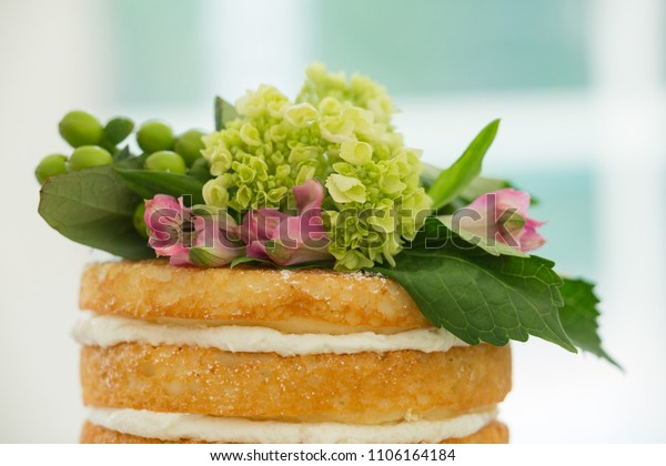 Close up of wedding cake floral topping design with green carnation