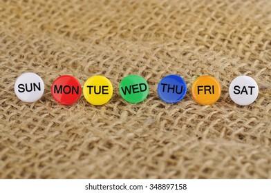 Close Up Of Weekly Push Pins