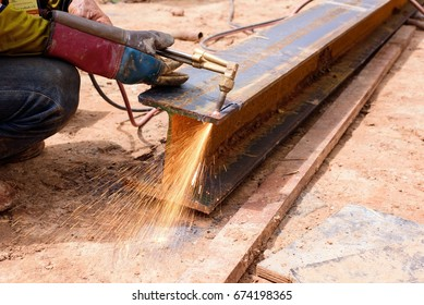 Close up welder hand cutting steel at construction site.Technical welding steel in factory.