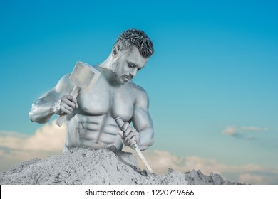 Close up of well build man with musclues and silver skin holding instruments in hands. Atlas making himself from mountain on background of blue sky and white clouds. Concept of motivation and working.