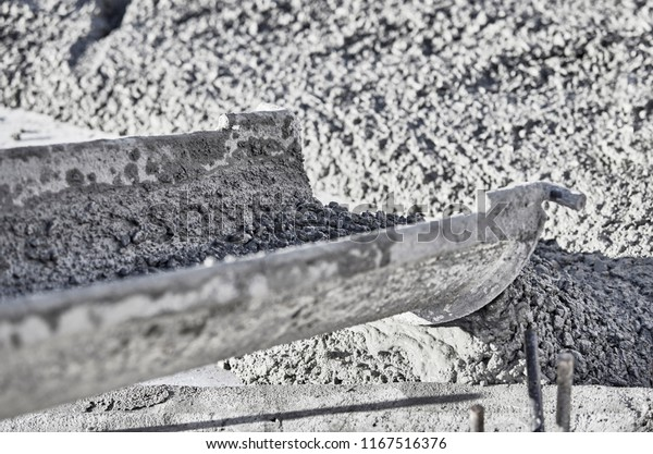 Close up of wet cement coming out of the shute