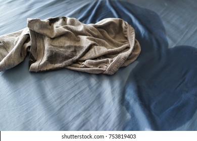 Close up of wet pant and mattress. Little boy pee in bed sheet. Child development concept.