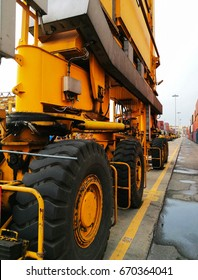 Close Up Wheel Rubber Tried Gantry Cranes (RTG) At Industrial Port.