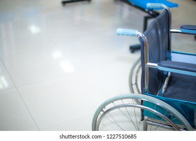 Close up wheelchair in hospital white tone.