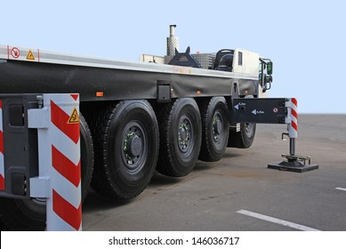 Close up of wheels of heavy truck with a platform
