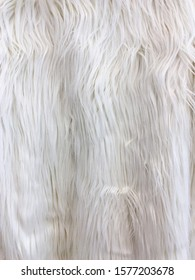 Close up white animal fur on the jacket as a background.