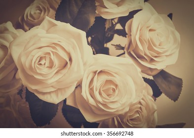 Close up of white Artificial rose with vintage and vignette tone