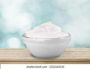close up of a white beauty cream or yogurt on white background with clipping path