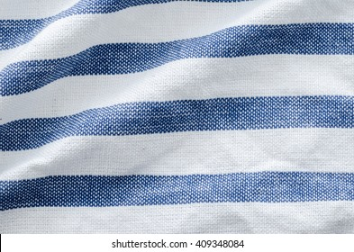 Close up of white and blue striped textile background