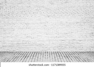Close up of  white brick wall and old concrete floor, interior room