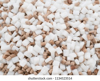close up White and Brown PET chips, master batch, polymer resin in laboratory, thermal storage master batch, plastic granulate for injection molding process.