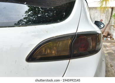 close up of white car taillight with old and dark color, old dark smoke light of car taillight not bright