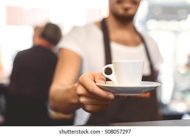close up of a white clean cup in hands of a man, selective focus
