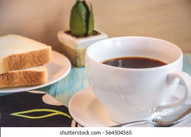 Close up white coffee cup on blue table Background / Selective focus