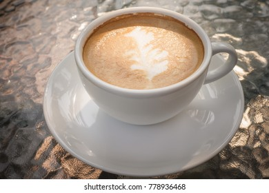 Close up white coffee cup with tree shape latte art
