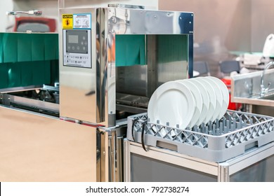 close up white dish on basket in automatic dishwasher machine for industrial
