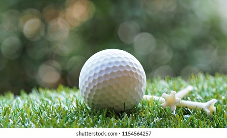 Close up white golf ball on green grass. Golf sports background.