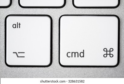 Close up of a white, gray computer keyboard. Focus on alt and cmd.