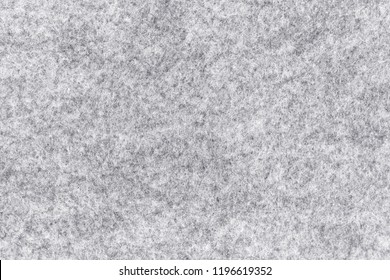 Close up white gray  melange felt background. Surface of fabric texture in white winter color.