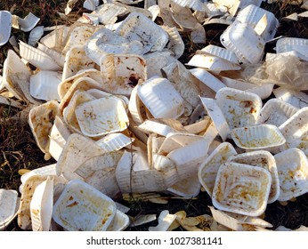 Close up white isolated photo of used foam thermocol plates with food stains heaped at a garbage in India, styrofoam pile trash