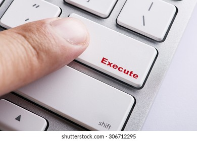 Close up white keyboard button conceptual-Execute