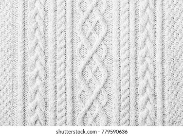 Close up of white knitted sweater background, texture with copy space