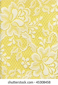 Close Up Of White Lace Floral Fabric On Yellow