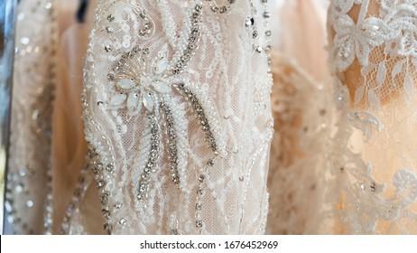 Close Up Of White Lace Wedding Dress