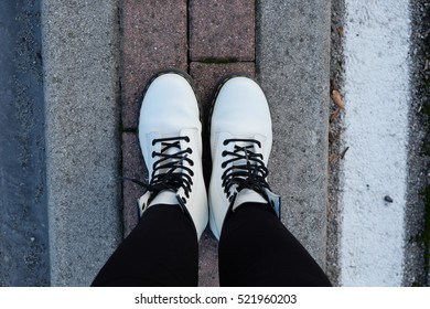 close up white of leather shoes on the floor
