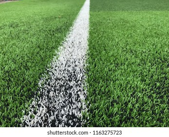close up white line on Artificial green field for soccer or football.