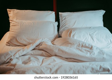 Close up white pillow  and white bedding sheets ,Sleeping condition after waking up.