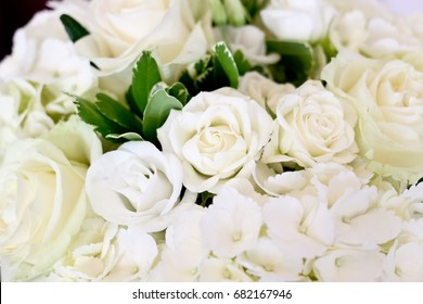 close up of a white rose bouquet of flowers in bloom for wedding party
