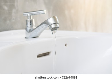 close up white sink with faucet