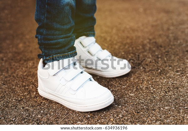 Close up of white trainers on child's feet