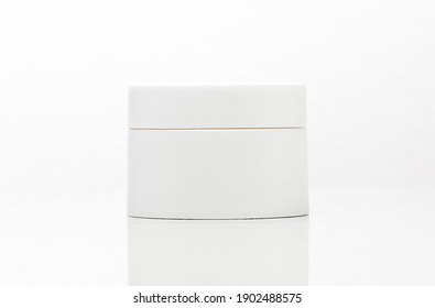 close up of a white unbranded cream jar on white background. cosmetic mock up. branding identity mockup concept.