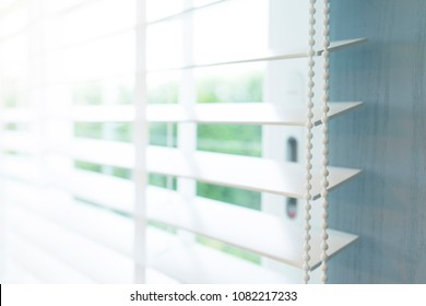 close up of white window blind at home