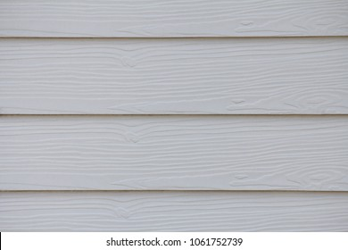 Close up white wood substitute board and high quality of fiber board texture and background for design and architect, Beautiful wooden plank patterns from cement striped wood wall for decorative