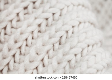 Close up of white wool with detail of woven pattern