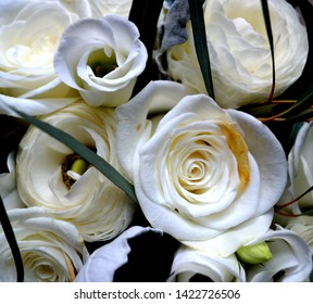 Close up of white Yorkshire roses wedding bouquet