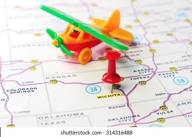 Close up of Wichita   Kansas   USA  map with red pin and airplane toy  - Travel concept