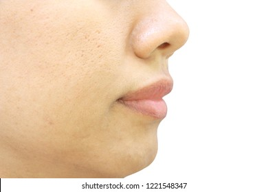 close up wide pores on oily face skin, nose and mouth which have problem skin of asia woman on white background have copy space on right side