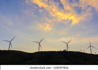Close up wind turbine on the hill with cloud sky background. Green energy power for electricity concept.