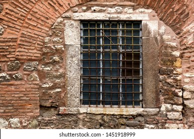 close up window of old brick building exterior of Hagia Sophia cathedral in Istanbul, Turkey