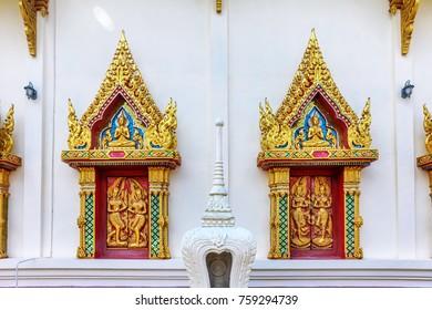close up windows bass-relief in Beautiful temple Wat Samai Kongka on Ko Pha Ngan, Thailand on a sunny day